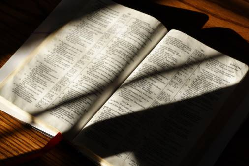 Open bible shadows